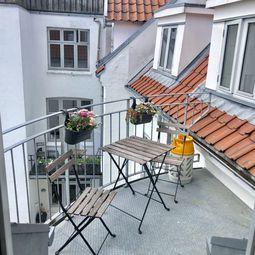 Hyggelig lejlighed med altan