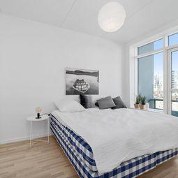 Delevenlig 4-værelses lejlighed med garanteret havudsigt
